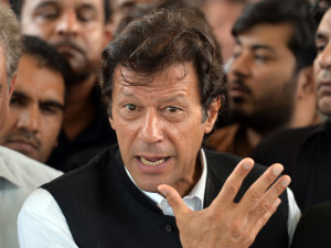 Pakistani politician Imran Khan gestures as he speaks with media representatives after a hearing at the Supreme Court in Islamabad on August 28, 2013. Pakistan's top court on August 28, 2013, dropped contempt charges against cricketer-turned-politician Imran Khan, accepting his explanation that he never intended to bring senior judges into disrepute. AFP PHOTO/ AAMIR QURESHI