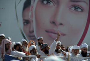 "Say ""Yes"" to a Blanket Ban: According to one online poll, 68% of Pakistanis wanted the ban to be permanent. Photo: AFP"