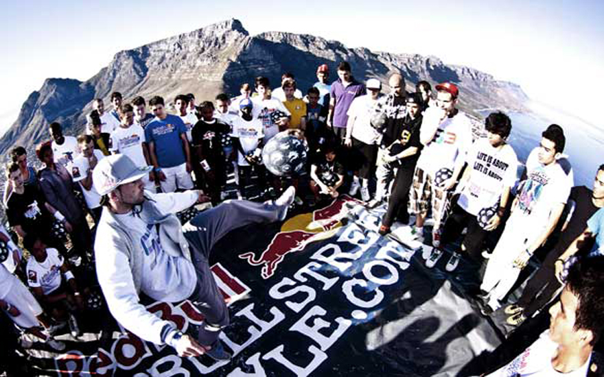 Freestyle footballer and previous world champion Séan Garnier of France (centre) gathers with other freestylers, including Areeb Iqbal of Pakistan, on Lion's Head in Cape Town to practice skills. Photo: Craig Kolesky/Red Bull
