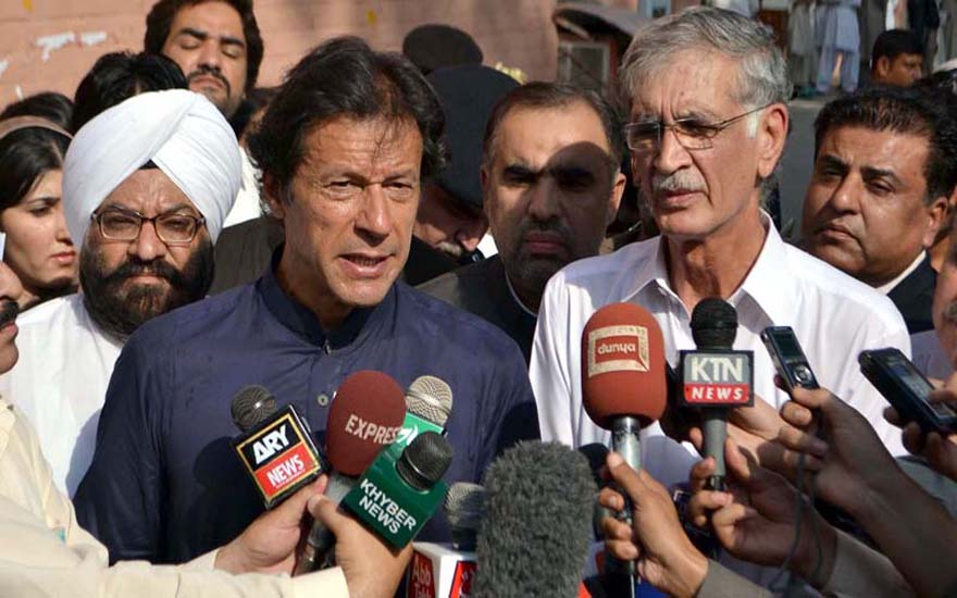 PESHAWAR, PAKISTAN, SEP 25: Tehreek-e-Insaf Chairman, Imran Khan talks to media persons during his visit to inquire after the health of Kohati Gate Church bomb blast victims at Lady Reading Hospital in Peshawar on Wednesday, September 25, 2013. (Fahad Pervez/PPI Images).