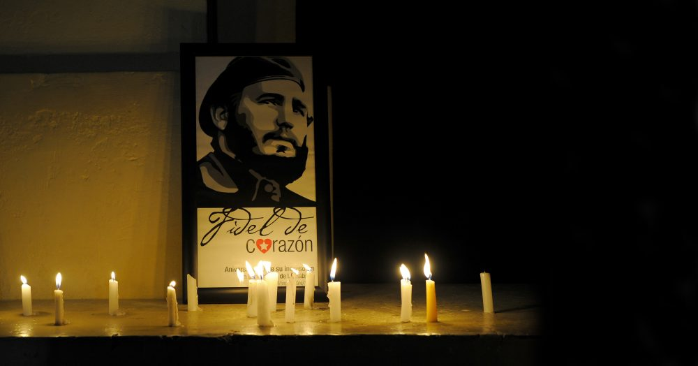 Students light candles in honour of Cuban historic revolutionary leader Fidel Castro a day after his death,