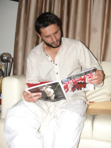 Newsline cover price: Rs100. A photo of Afridi intently reading the magazine: priceless. Photo: Saif Karamali