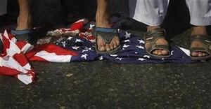 ji-protest-osama-us-flag