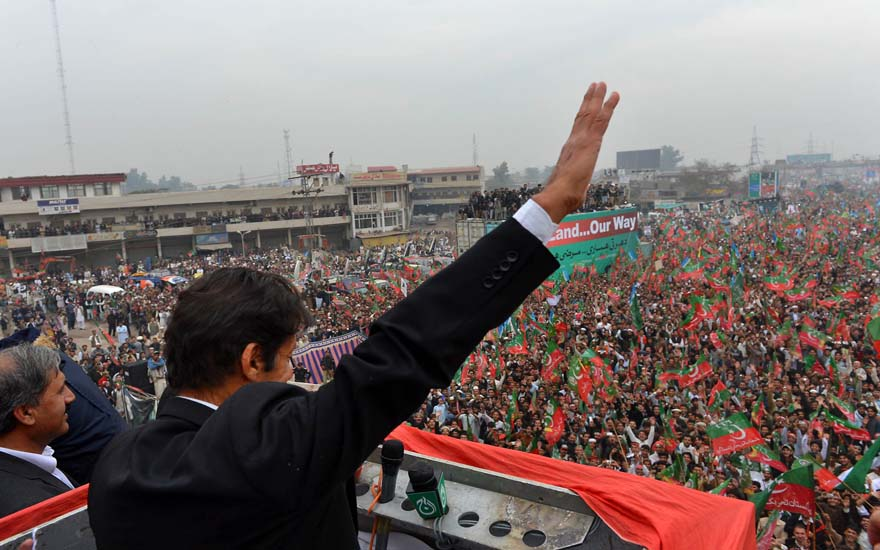 Imran Khan, Chairman of Pakistan Tehreek-e-Insaaf (PTI) party, gestures while addressing a protest rally in Peshawar on November 23, 2013. Thousands of Pakistani activists from right-wing political parties November 23 protested against US drone strikes, threating to block NATO supply routes, if strikes continue. AFP PHOTO/A MAJEED