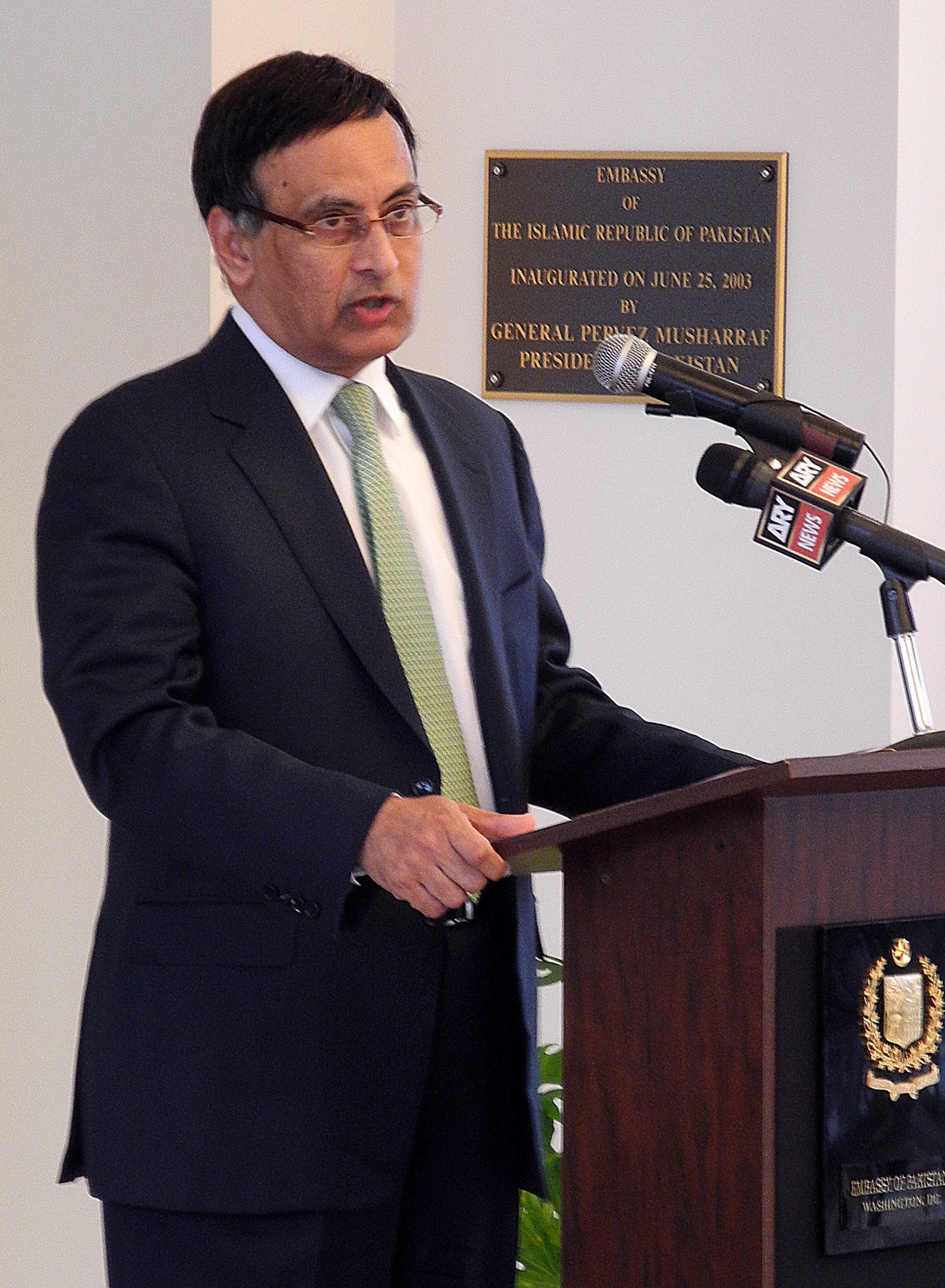 "(FILES) This file photo taken on March 9, 2011 shows Pakistan's ambassador to the United States, Hussain Haqqani, addressing a memorial service in honor of slain minister for minorities Shahbaz Bhatti at the embassy in Washington. The White House said on November 22, 2011 that the resignation of Haqqani, was an ""internal issue"" for Pakistan but praised him as ""a very close partner."" Pakistan's government said earlier that it had asked Haqqani to resign and ordered a probe into claims that he sought American help against the country's powerful military. AFP PHOTO / FILES / SHAUN TANDON"