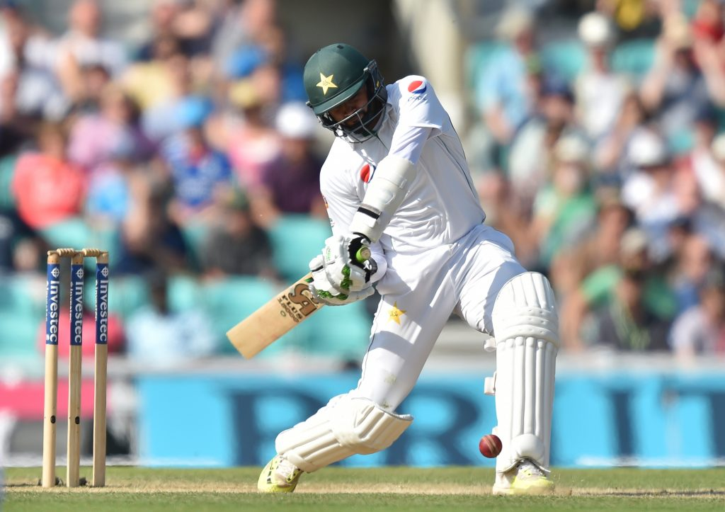 Pakistan's Azhar Ali hits a six, the winning runs during play on the fourth day of the fourth test cricket match between England and Pakistan at the Oval in London on August 14, 2016. Yasir Shah took five wickets as Pakistan marked the country's Independence Day with a 10-wicket win over England in the fourth Test at The Oval on Sunday. Victory saw Pakistan end the four-match series all square at 2-2 on an Oval ground where they won their first Test match in England back in 1954. / AFP PHOTO / OLLY GREENWOOD / RESTRICTED TO EDITORIAL USE. NO ASSOCIATION WITH DIRECT COMPETITOR OF SPONSOR, PARTNER, OR SUPPLIER OF THE ECB