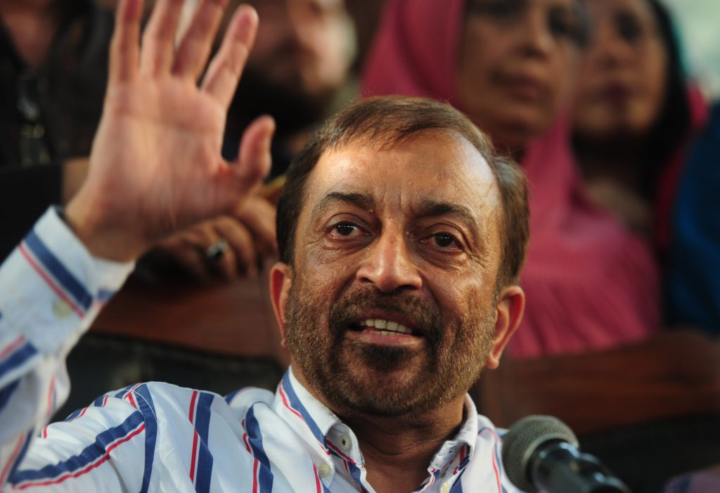 Pakistani Muttahida Qaumi Movement (MQM) political party leader Farooq Sattar gestures as he addresses a press conference in Karachi on August 23, 2016. Pakistani police charged the exiled leader of an influential political party with treason and inciting terrorism, accusing him of provoking violence at a protest a day earlier in Karachi. Altaf Hussain, leader of the Muttahida Qaumi Movement (MQM) which rules Karachi, Pakistan's biggest city, was accused with a dozen other party leaders of raising anti-Pakistan slogans at the demonstration on August 22, 2016. / AFP PHOTO / ASIF HASSAN
